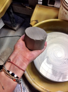 Before throwing the clay onto the wheel